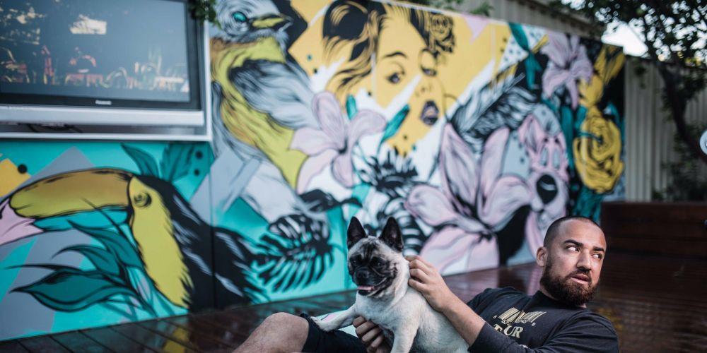 Artist Dipesh 'Peche' Prasad is painting a mural in Walt Drabble Lane in Claremont.