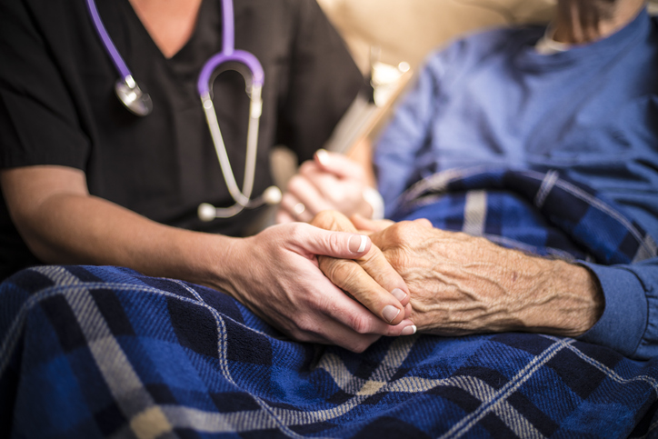 A hospice nurse visits an Elderly male patient who is receiving palliative care. Picture: iStock