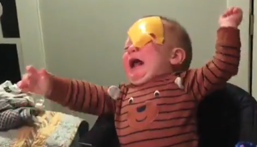 Viral videos show parents throwing cheese slices at babies