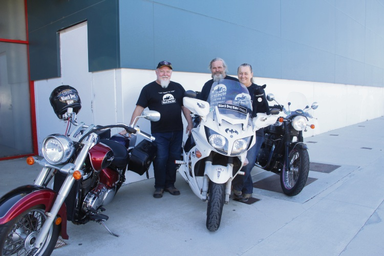 Keith Wellfare, Chris and Dianna Glover with black dog 'Winston'. Every rider will get a Winston for the ride.
