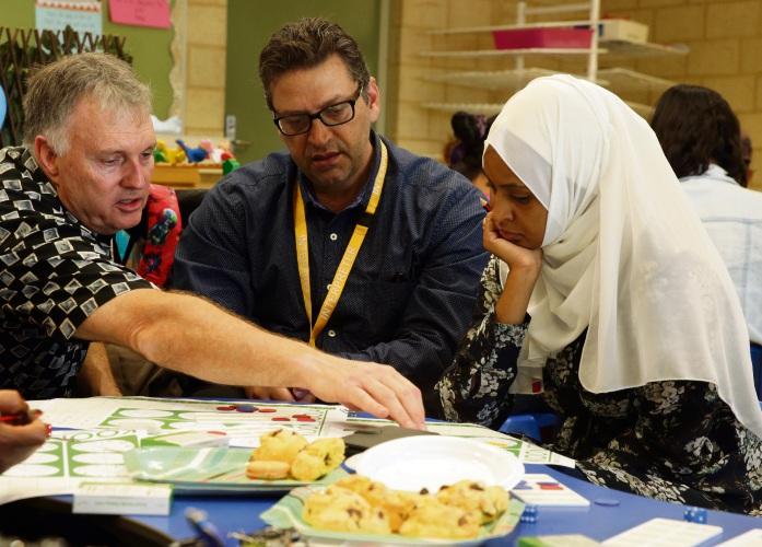 Maths expert Dr Paul Swan, Omar Baydoun (Interpreters on Call) and parent Jewahr Berhanu. Picture: Martin Kennealey d491596