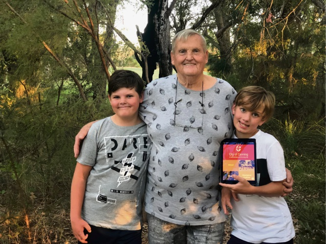 Robin Forrester (centre) taking the This is Canning app for a test with (L-R) Jai Grieve (11) and Hudson Grieve.