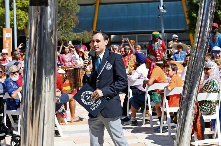 Brian Sobel from Guiness World Records speaks to the crowd before the attempt.  Photo: David Baylis
