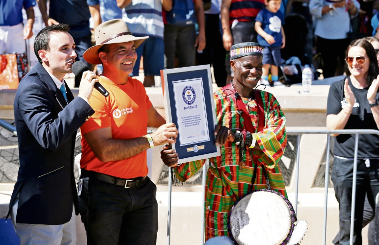 Brian Sobel from Guiness World Records with Mark Irwin (Mayor, City of Stirling) and drummer Paul Osei Kofi with the world record.  Photo David Baylis