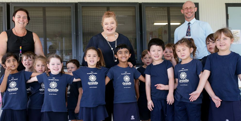 Grandis Primary School teacher Cherie Pearse, Education Minister Sue Ellery and principal Stephan Bevan with pre-primary students. Picture:  Martin Kennealey d491657