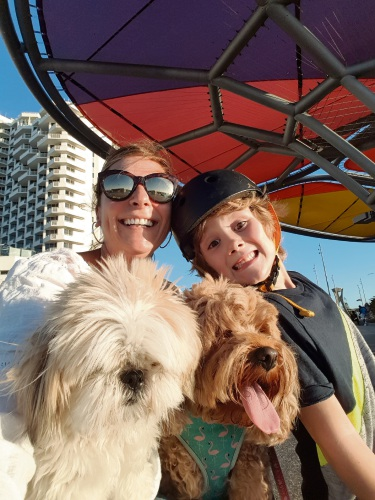 Sarah and Jacob Bates enjoying the Scarborough skate park with dogs Poppy and Bonnie.