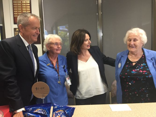 Labor leader Bill Shorten and Canning Labor candidate Mellisa Teede chat with hospital gift shop volunteers Pat Robinson and Edna Prout during their visit.
