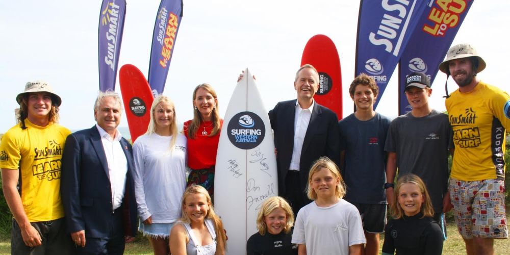 Opposition Leader Bill Shorten and Labor's Stirling candidate Melita Markey with Surfing WA representatives in Trigg.