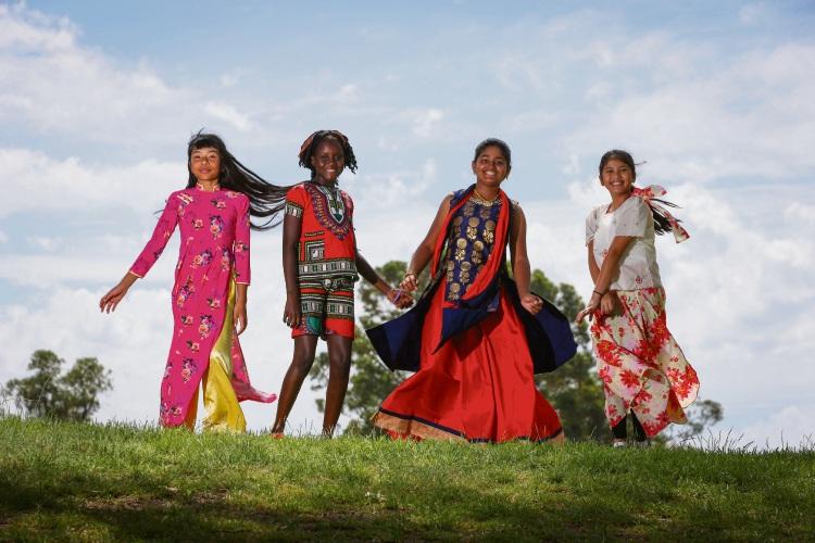 Karen Tran, Wanuto Omto Othow, Vedika Mote and Elisha Descutido take part in North Balga Primary School's Harmony Day celebrations. Picture: Andrew Ritchie d491717