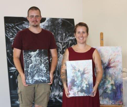 Cameron and Ashlee Rose were presented with their own copies of the paintings seen in the background.