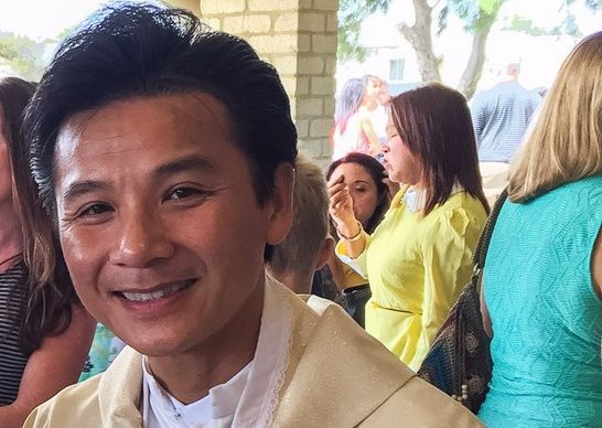 Father Joseph Tran photographed after Mass in 2016. Picture: Twitter