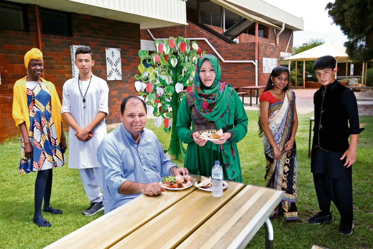 L-R: Lynwood Senior High School students Penda Yare Janneh (15) and Omid Hassani (16) with parents Jafar and Bazira Rahimi of Thornlie and students Dilani Karunakaran (16) and Hassan Habibi (15).Picture: David Baylis. d491850