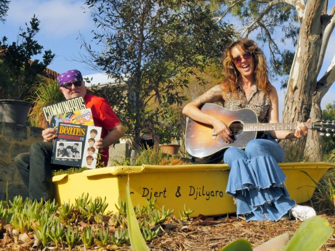 Vinyl collector Kim Williams and musician Dee Walsh on one of the front verges of Murray Street that will transform into a performance stage on Sunday. Picture: Mel Anastas.