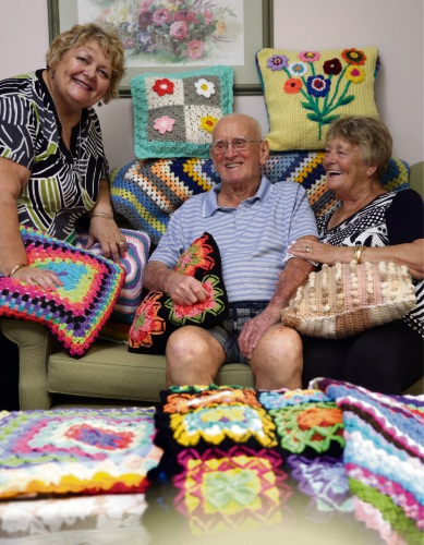 Karen Gilmore and Eleanore Rigby from Knit and Natter with Mercy Place Edgewater resident Jeff Miller. Picture: Martin Kennealey d490853