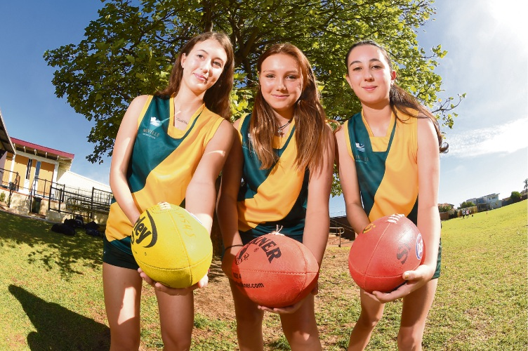 Melville Senior High School students Francesca Gratton, Holly Garbin and Lili Sciberras-Milthorpe have joined the school's first female Australian rules football team. Picture: Jon Hewson