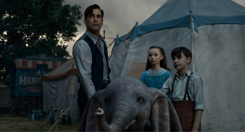 Colin Farrell, Nico Parker and Finley Hobbins with Dumbo.