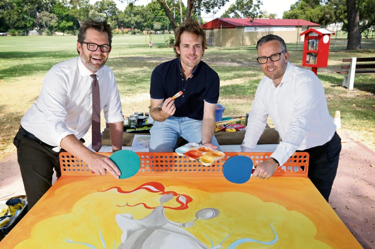 L-R: Cr Dan Bull (Mayor, City of Bayswater), Artist Peter Ryan and Scott Greenwood (General Manager, Hawaiian Suburban Shopping Centres). Artist Peter Ryan is painting the new table tennis table at Morley Noranda Recreation Club. The project is funded by the City of Bayswater and Hawaiian''s Noranda. Picture: David Baylis www.communitypix.com.au d491691