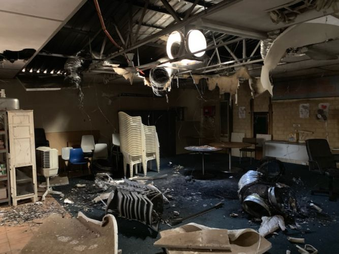 A photo taken inside the community building that was damaged by the fire.