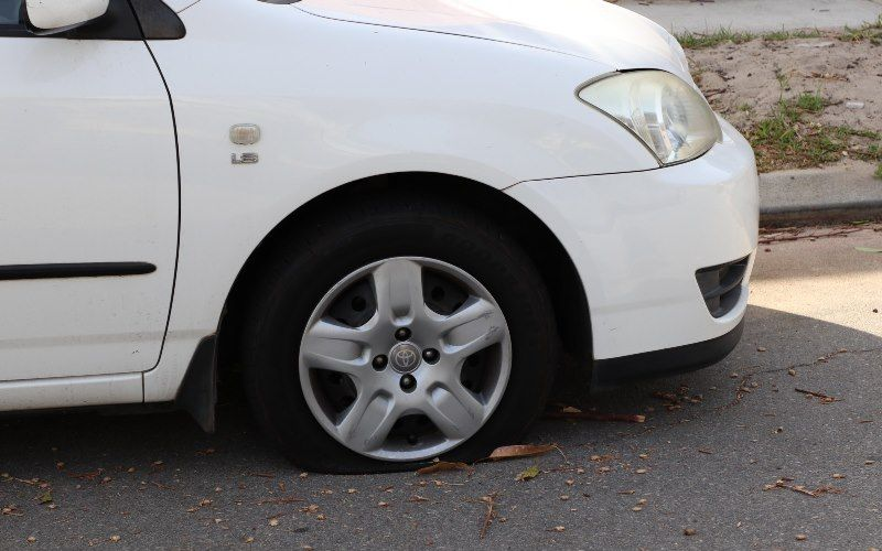 Residents are angry their tyres were slashed overnight. Picture of car with flat tyre in Hickory Street: Anton La Macchia