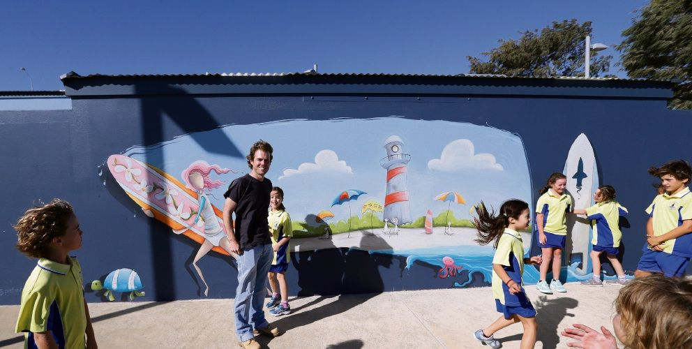 Mullaloo artist Peter Ryan with Mullaloo Beach Primary School students at the Sorrento mural. Picture: Martin Kennealey d491893