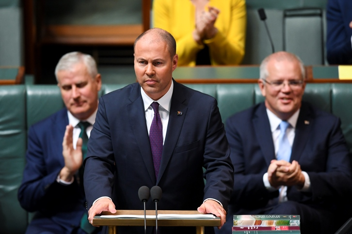 Josh Frydenberg delivers his first Federal Budget, flanked by deputy PM Michael McCormack (left) and Prime Minister Scott Morrison.