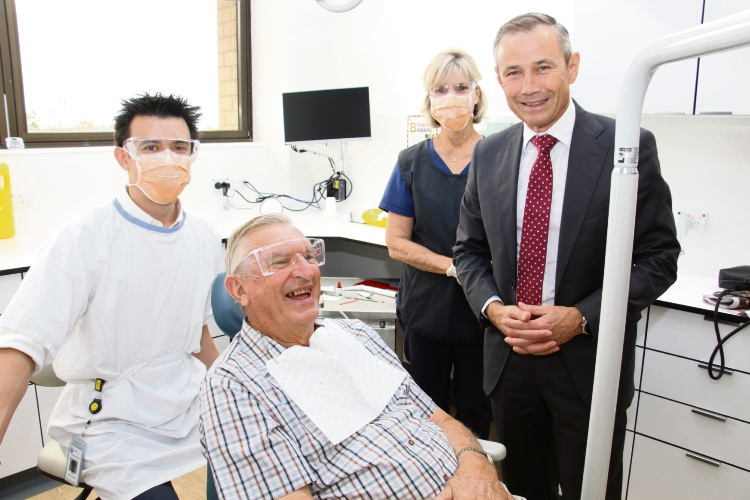 First patient at the new clinic Kenneth Goodes chats with Minister for Health Roger Cook watched on by Dental Officer is Daniel Sheehan, Dental assistant is Jacqueline Vojkovic.