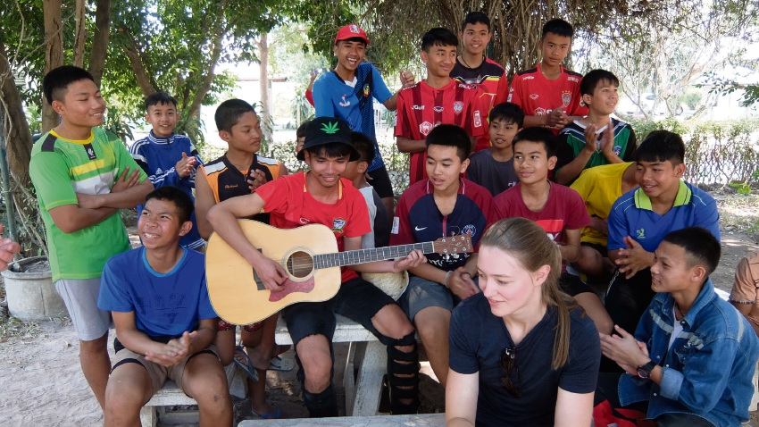 A group of boys at Boystown playing music for Joondalup club president Eliza Bourgault du Coudray.