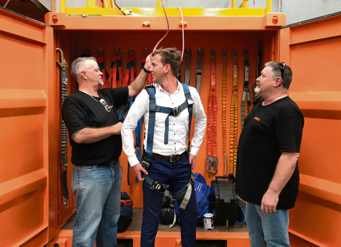 Upskill Work Safe registered assessor Gary Norris straps Mayor Rhys Williams into a harness for height training, watched by chief executive Brett Young.