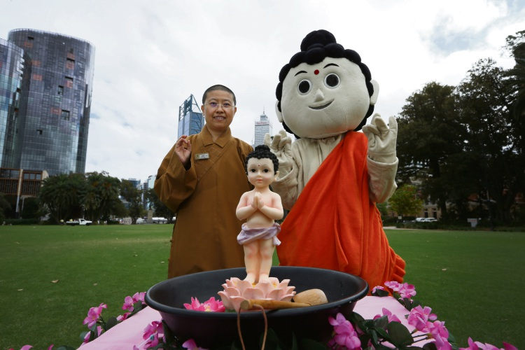 Venerable Miao Bo (Fo Guang Shan Temple Maylands) with Baby Buddha. The Buddhist Light International Association of WA and Fo Guang Shan Temple in Maylands is holding their annual Buddha''s Birthday and Multicultural Festival from April 13 to 14 at Supreme Court Gardens Picture: Andrew Ritchie www.communitypix.com.au d492137