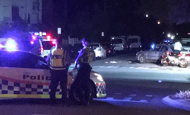 Police at the scene in Broome Street, Highgate, Sunday night. Picture: Mark Donaldson