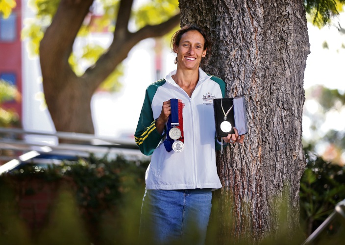 Kylie Wheeler of Hillarys with some of her Manchester and Melbourne Commonwealth Games medals.  Retired heptathlete and six-time national champion Kylie Wheeler has been chosen as the ambassador for the City of Bayswater''s annual Have a Go Day on April 14 at The Rise in Maylands. Picture: David Baylis www.communitypix.com.au   d492136