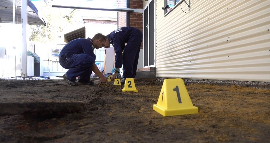 Forensic police search the home in West Perth this morning. Photo: WA Police
