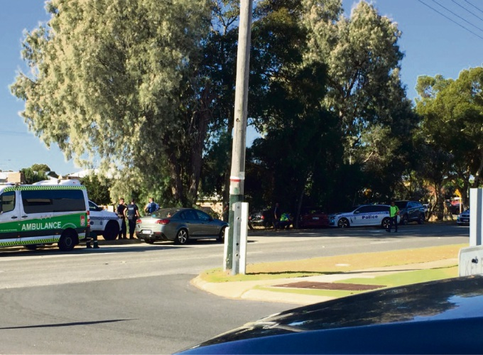 Police after arresting the man on Karrinyup Road. Photo: Monique MacLennan.