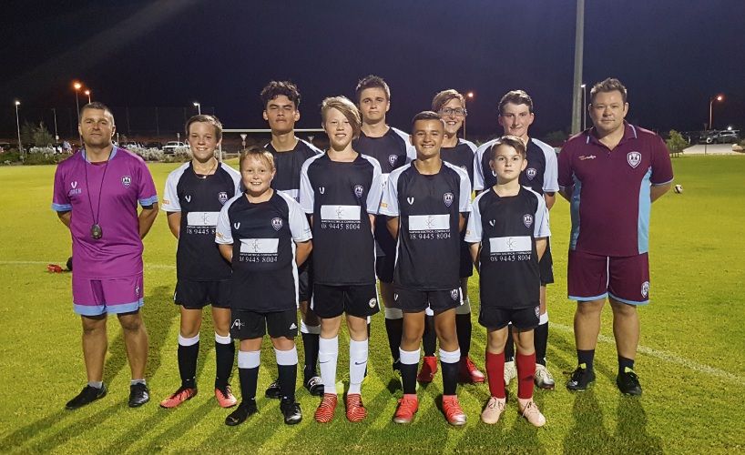 Yanchep United Football Club junior players with coaches John Baker and Shaun Parkin.