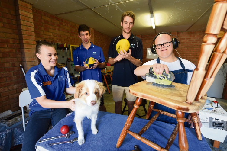 d492159 Proudly Productive work coach Julie-Anne Norrish, therapy dog Albus, team member Chris Minutillo, work coach Dylan Swallwood and team member Alex Tilly Picture: Jon Hewson