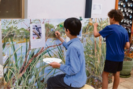 Year 6 students from Chrysalis Montessori School painting the mural.