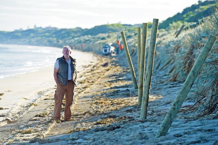 Neil Mulligan at the fence in May after it was damaged during storms.