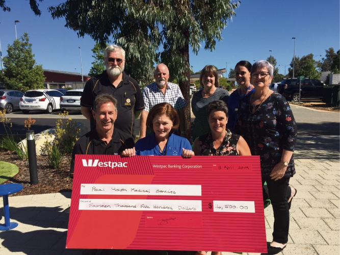 Mike Kirke, Graeme Jenkins, Tara Hay, Carlene Brown and (front) Barry Sinclair, Louise Wright and Eleanor Britton with the cheque.