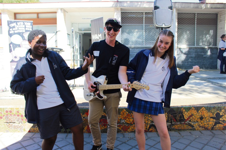 Singer-songwriter Brayden Sibbald with Como Secondary College music students Deon Nweke (16) and Alice Annetts (16).