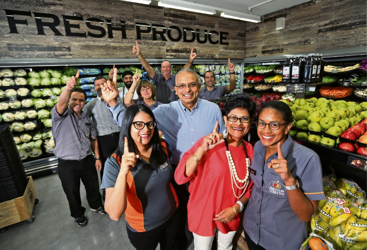 Preston St IGA owner Pierre Sequeira celebrates in store with his family and staff. Picture: David Baylis