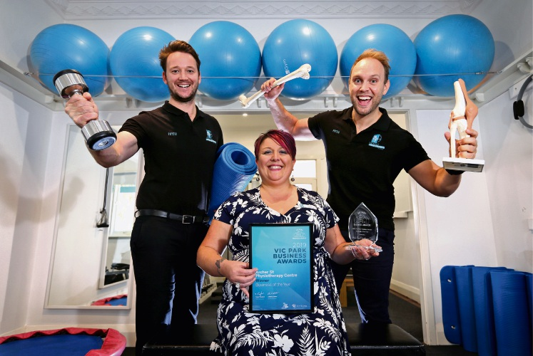Archer Street physio staff Ned Prendergast, Lisa Waterworth and Patrick Renner celebrate their win. Picture: David Baylis