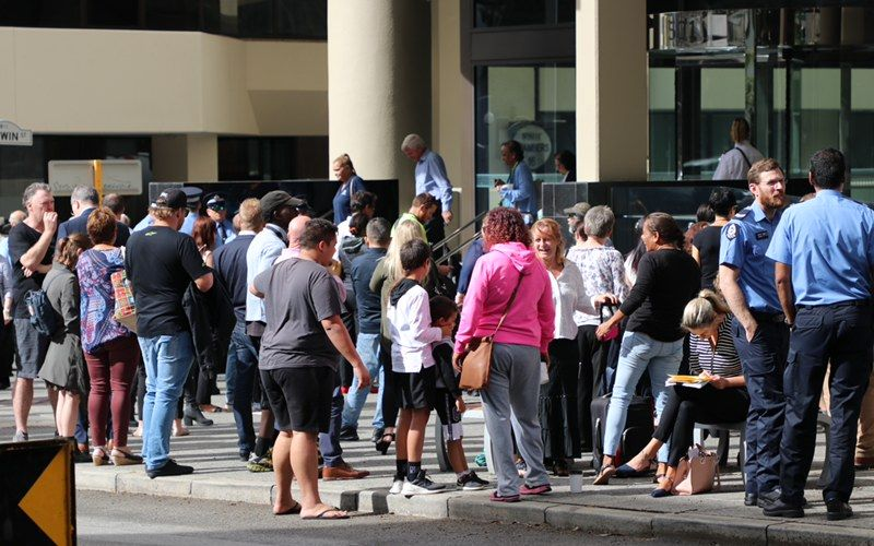 People filing on to the footpath after Perth Magistrates Court was evacuated. Picture: Anton La Macchia