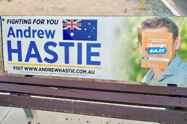 Canning MHR Andrew Hastie's face has been covered by an Australian Unions sticker on a local seat advertisement.