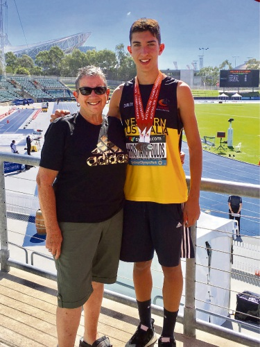 Jacob Hristianopoulos (15) with coach Lee Derby.