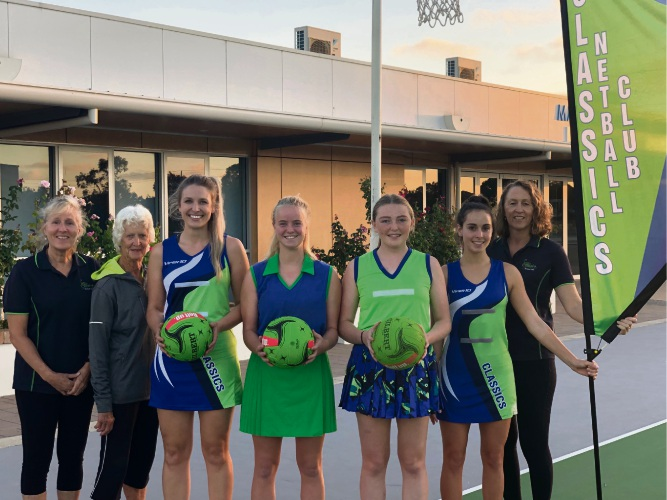 Shelley Jamieson with her mum Dot Lavater and sister Dianna Glynn (far right) with players Alex Smith, Lily Quinlivan, Delta Meade and Hannah Gulev showing how the club's uniform has changed