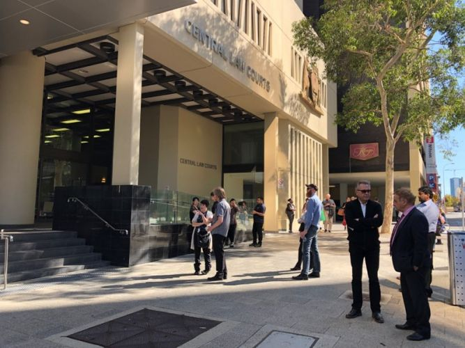 People evacuated again outside of Perth's Central law Courts building. Picture: Anton La Macchia