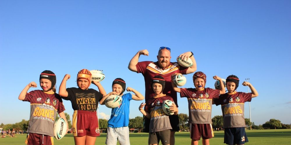 Gregg Pearson with juniors from the Joondalup Giants Rugby League.