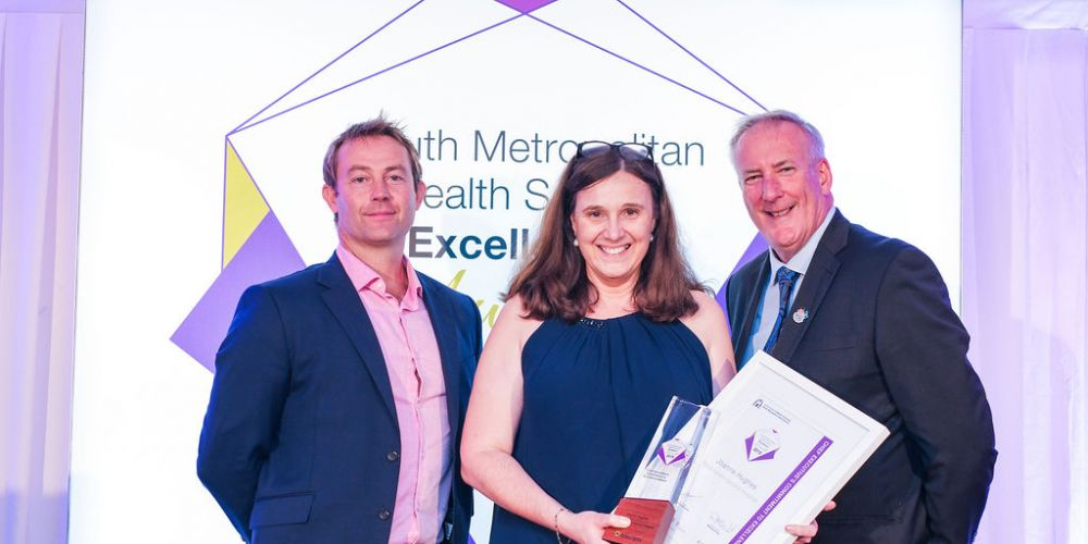 RGH nurse unit manager Joanne Hughes was presented with the Chief Executive's Commitment to Excellence award by Allscripts general manager for Australian and New Zealand Todd Haebich and SMHS chief executive Paul Forden. 492710p