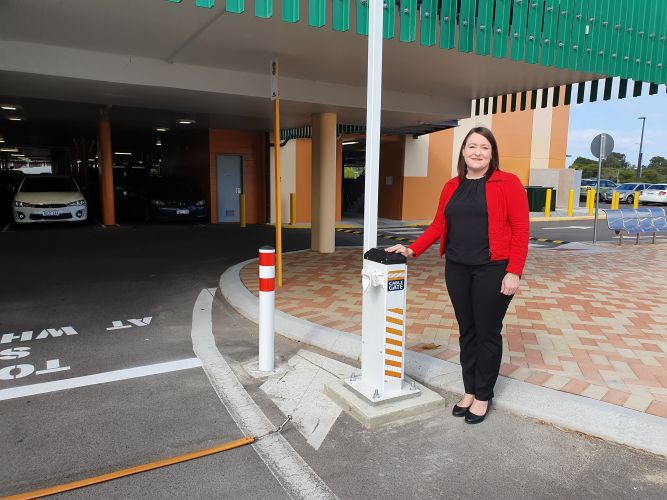 Joondalup MLA Emily Hamilton checks out the cable gate at Edgewater train station.