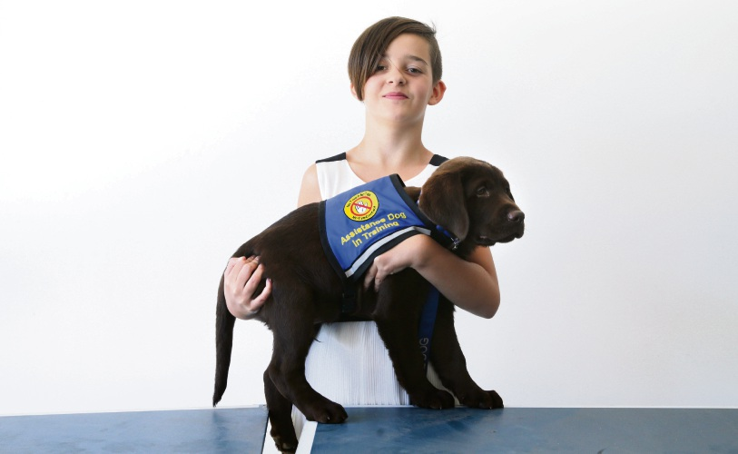 Tilly Schmidt (11), of Joondalup, with James Brown from Wagamuffins Dog Training. Picture: Martin Kennealey d490427
